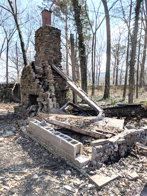 An old stone fireplace is all that remained.