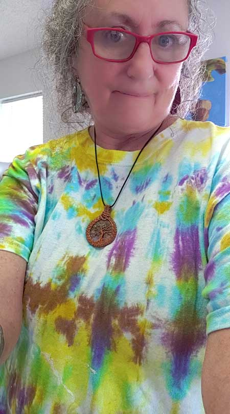 Tie-dyed T-shirt in Turquoise, Purple and Yellow