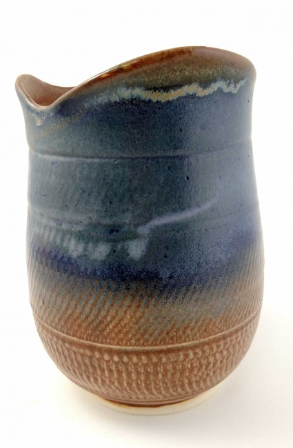 Blue and brown vase with wave lip